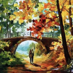 Őszi erdőben sétáló pár